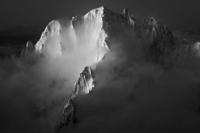 Aiguille verte - wooden photo frame of the Green Needle Mountains chamonix in fog and clouds