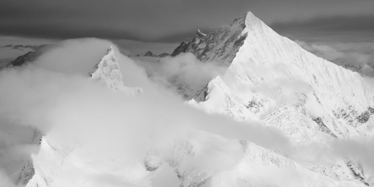 Black and white mountain panorama of Zinalrothorn and Weisshorn